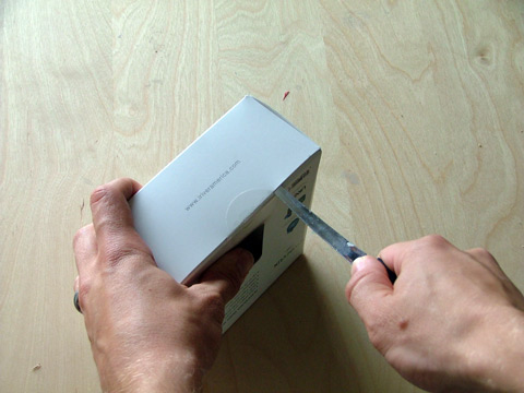 Cutting open the iRiver clix package
