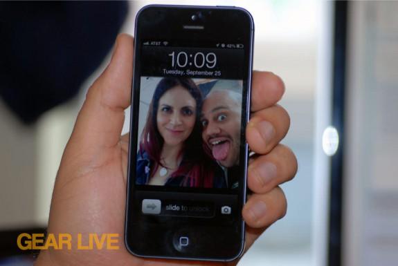 iPhone 5 black & slate holding lock screen