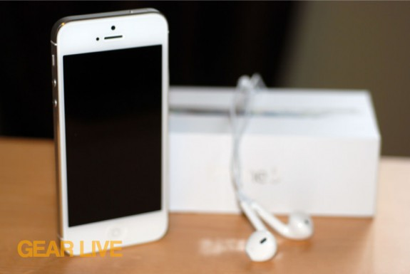 iPhone 5 White & Silver next to box and EarPods